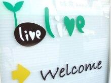 リヴ(live)の雰囲気(入り口、このマークが目印です!)