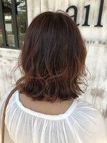 エル(ailes)毛先の一本一本まで可愛いソフトオレンジ色