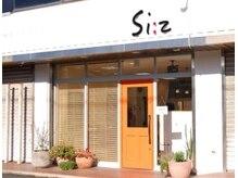 ヘアー エフェクト シィーズ(hair effect Si Z)の雰囲気(オレンジのドアが目印)