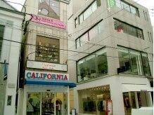 エクステンション キュッキュ 鹿児島店(EXTENSION Q9)の雰囲気(テンパーク通りの3F!このピンクの看板が目印)