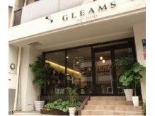 グリームス ヘアデザイン(GLEAMS Hair Design)の雰囲気(目印は白い壁と緑がいっぱいの外観)