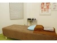 昇降機能付きの矯正ベッド