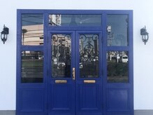 セットアップ 倉敷中庄店(SET-UP)の雰囲気(青いドアが目印です)